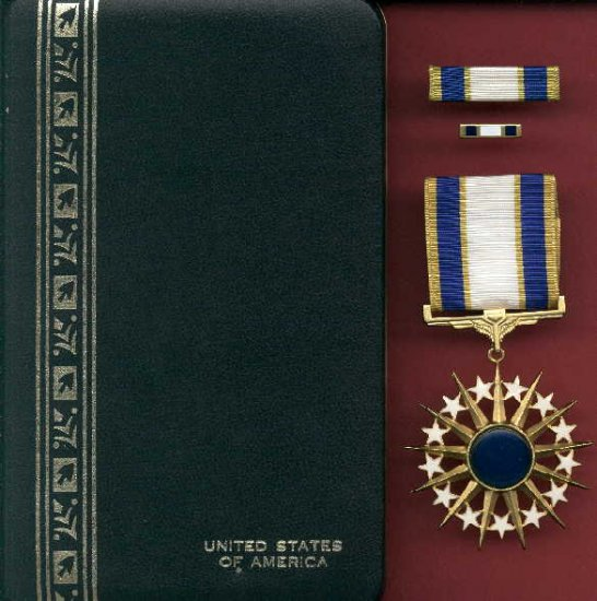 US Air Force Distinguished Service medal in case with ribbon bar and lapel pin