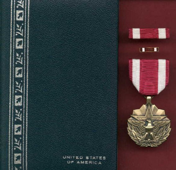 US Meritorious Service Award medal in case with ribbon bar and lapel pin