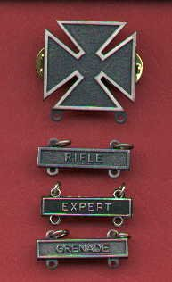 Marksman badge with three qualification bars
