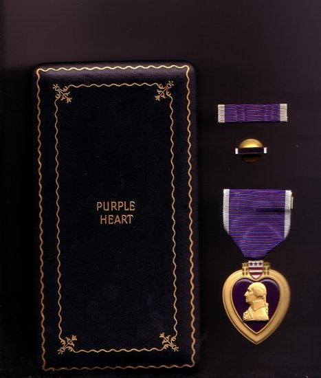 Purple Heart medal in WWII case with ribbon bar and lapel pin