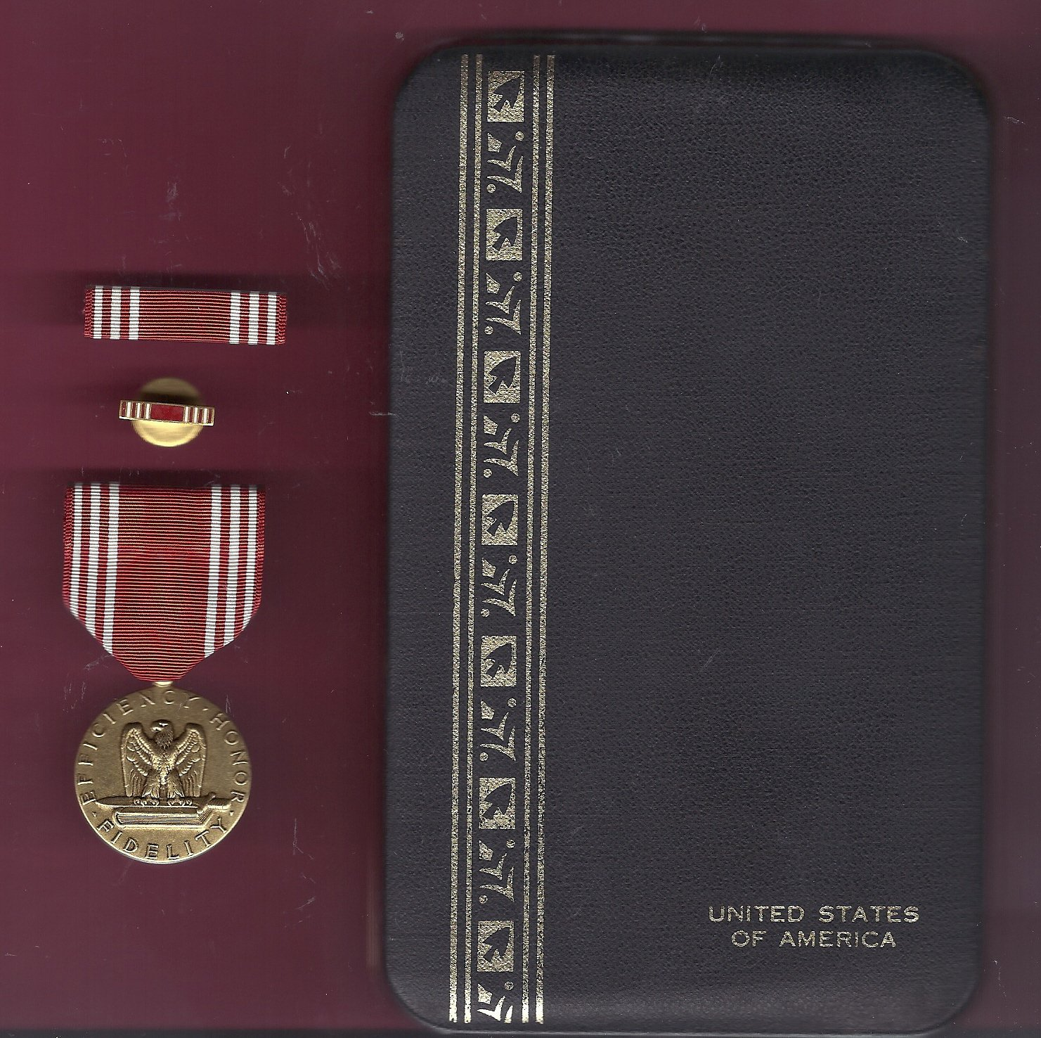 Army Good Conduct medal in case with ribbon bar and lapel pin