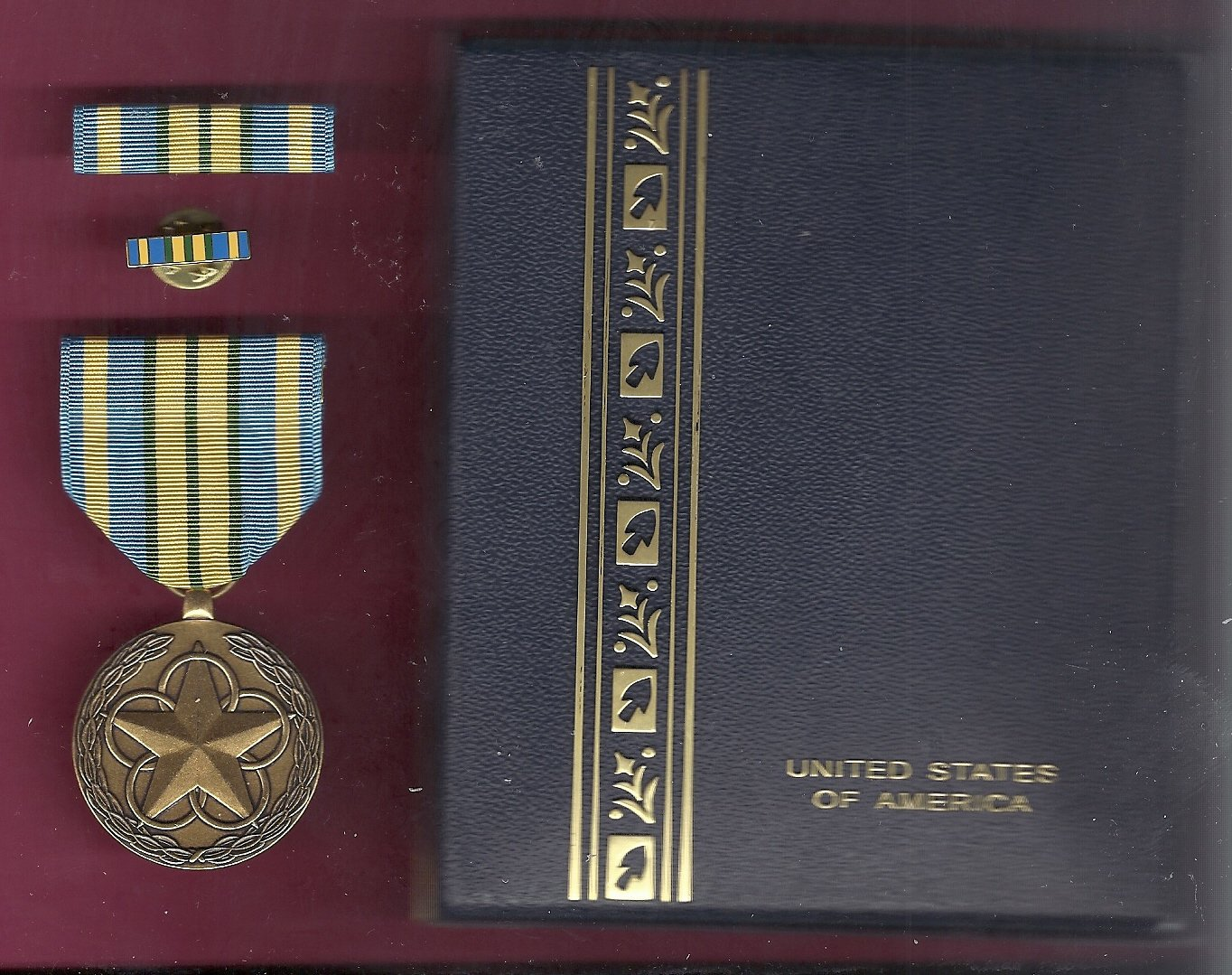 Outstanding Volunteer Service medal in case with ribbon bar and lapel pin