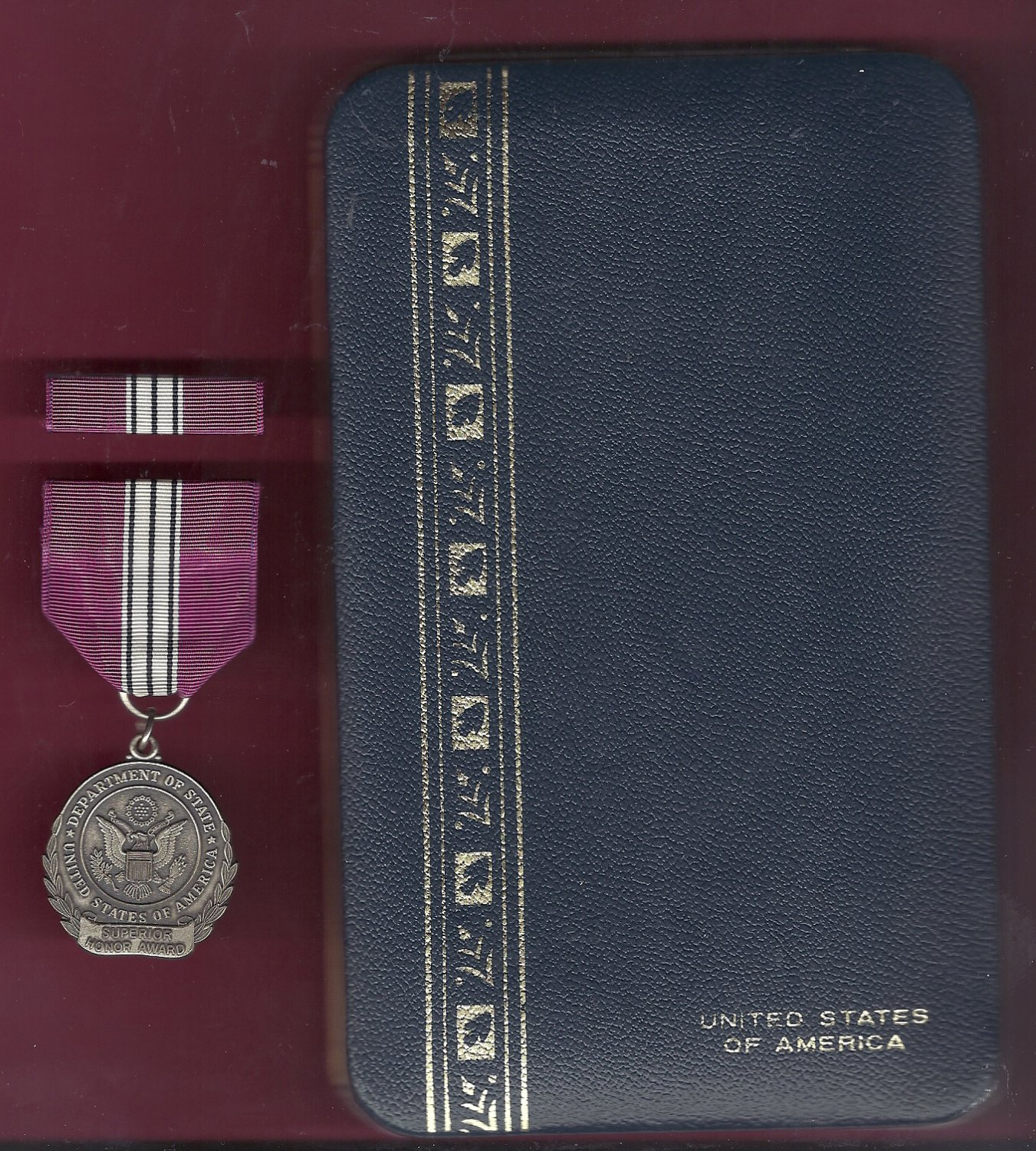 State Department Superior Honor Award medal with ribbon bar in case