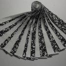 """Jelly Roll-White on Black Novelty Print w/White Blender-20-2-1/2"""" x 43"""" Strips"""
