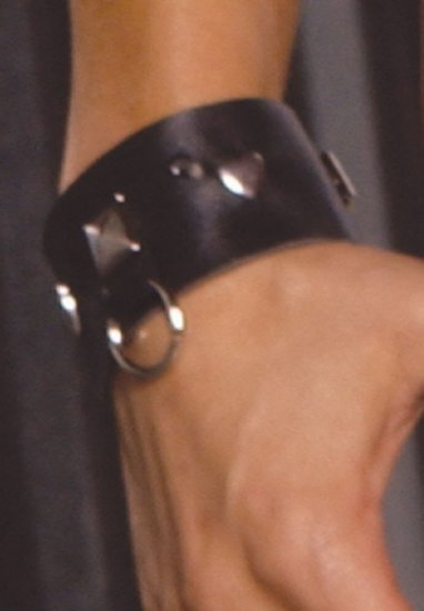 Leather wrist cuffs with square nail heads and O rings
