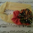 Yellow and orange spring hair band