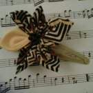 yellow and black hair clip
