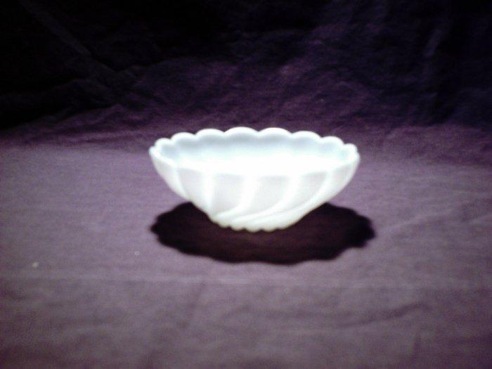 Medium sized white glass bowl swirled design (milk glass?)