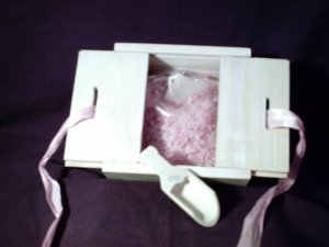 Collectible box with bath salts, pink ribbon and wooden scoop