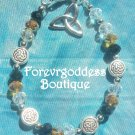 Amber colored crystals  w/celtic knot charm