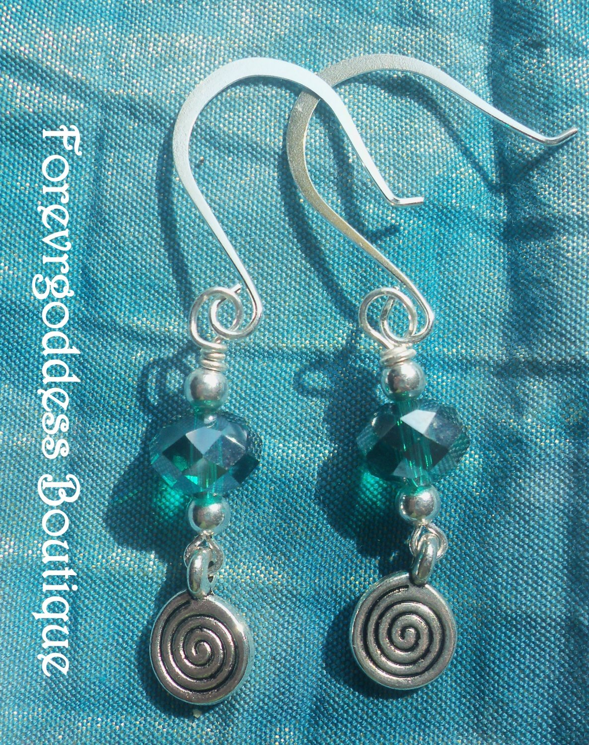Teal crystals and Swirl  earrings