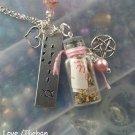"""Love"" spell bottle necklace"