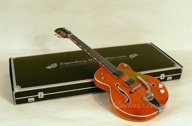 "Brian Setzer's Orange ""Dice Knobs"" mini guitar replica"