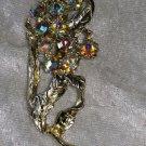 Gold tone Aurora Borealis rhinestone flower leafs abstract vintage pin brooch