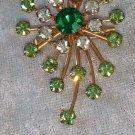 Star burst rhinestone pin brooch timeless swirl emerald green Vintage