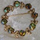 vintage pin brooch wreath of aurora borealis green flowers gold tone