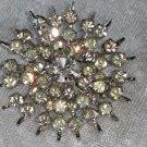 Vintage pin brooch star burst clear rhinestones nice loads or rhinestones