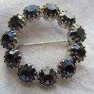 Vintage pin brooch black smokey circle of rhinestones stunning