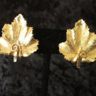 BSK Signed Gold tone vintage earrings maple leaf Canada textured clip on