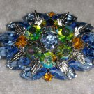 Vintage pin brooch Aurora borealis Blue & amber rhinestones what a shine.
