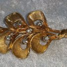 Vintage pin brooch gold tone 6 leaf with clear rhinestones in it flower leaf