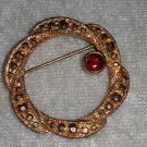Wreath intertwined gold tone garnet gold tone pin brooch vintage timeless