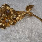 Gold tone aurora borealis flower bunch vintage pin brooch