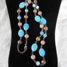 Necklace wood beads. Lucite plastic ocean blue and tan beads iridescent opaque