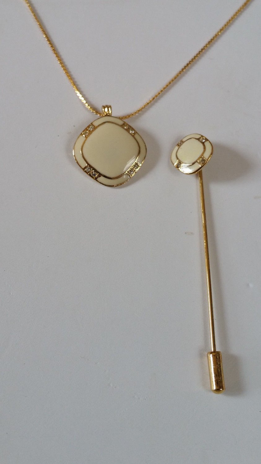Vintage stick pin and necklace white enamel and rhinestone Gold tone