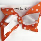 ORANGE WITH WHITE POLKA DOTS HAIR BOW