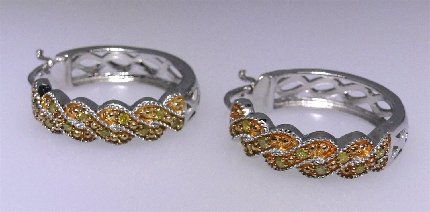 Sterling silver earrings set with diamonds, brand new