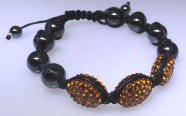Bracelet with Hematite beads with orange sparkle decor, new not worn