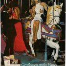1978 Gentlemen prefer Hanes Pantyhose Ad~Pretty Lady on Carousel Horse Ride~70s