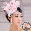 Bridal headdress of pink flowers touched