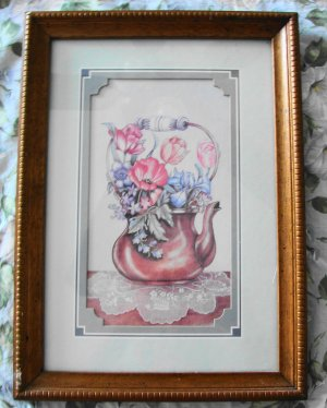 Picture of teapot with bouquet and lace