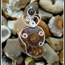 Ammonite Fossil Pendant, wrapped in Silver and Copper with Tigers Eye