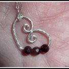 Garnet Floating Heart Pendant in Sterling Silver, with chain
