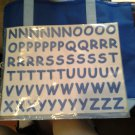 blue bag w/ letter stickers