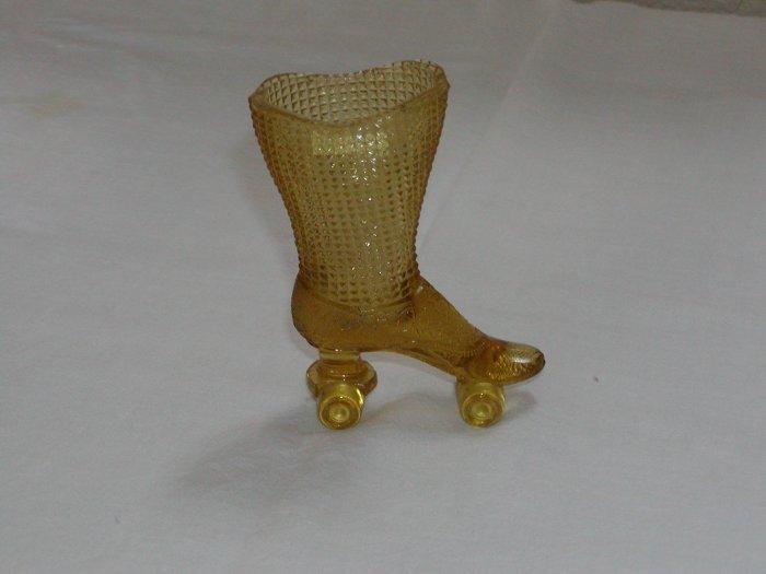 Amber Glass Boot on Skates (Central Glass Works of Wheeling, W. Va circa 1964-1974).