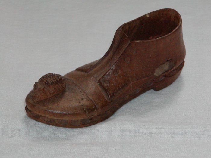 Man's Wooden Shoe with Mouse on Toe