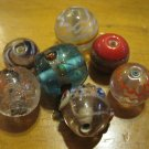 Assortment of 7 Glass Beads
