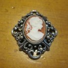 Silver Filigree Setting with Orange/Brown Background Cameo, Pendant