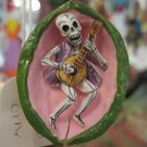 Day of the Dead Skeleton Playing Guitar in Walnut Ornament