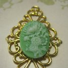 Green and White Flower Cameo on Gold Tone Filigree Setting