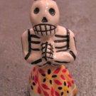 Ceramic Day of the Dead Figure, Woman in Light Orange Skirt with Dark Blue Flower Design