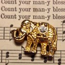 Gold Colored Metal Elephant Charm with Rhinestone