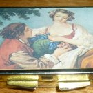 VINTAGE METAL PILL BOX WITH RENAISSANCE PICTURE LADY AND GENT