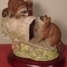 CHARMING FIGURINE RACOONS OCCUPYING A MAIL BOX
