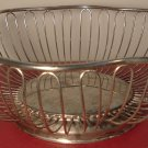 VINTAGE SILVERPLATED WIRED FOOTED FRUIT BASKET SCALOPED EDGES