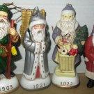 CHARMING COLLECTIBLE SET OF 4 CERAMIC SANTA CLAUS CHRISTMAS ORNAMENTS